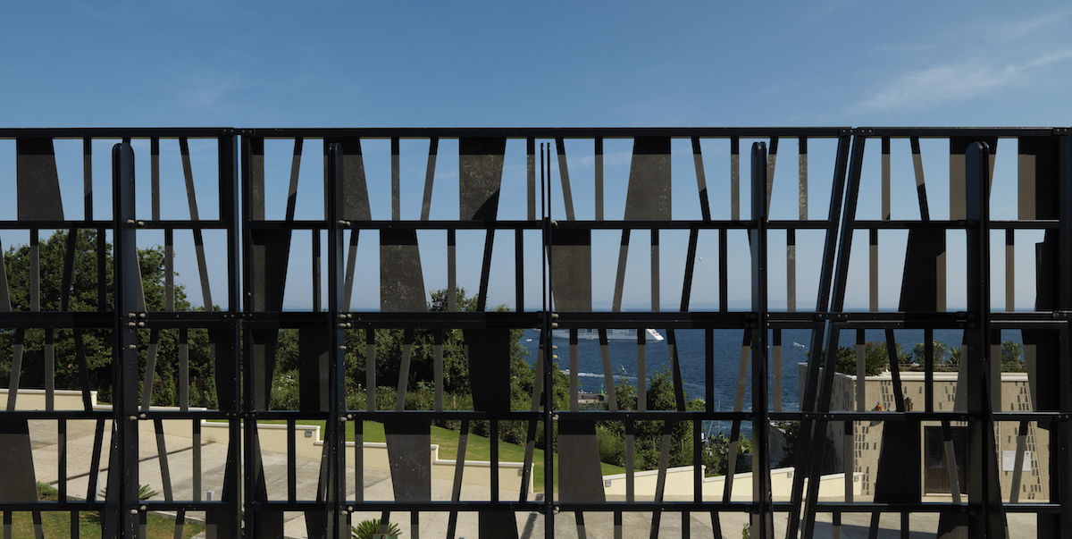 A perforated gate looking out over capri
