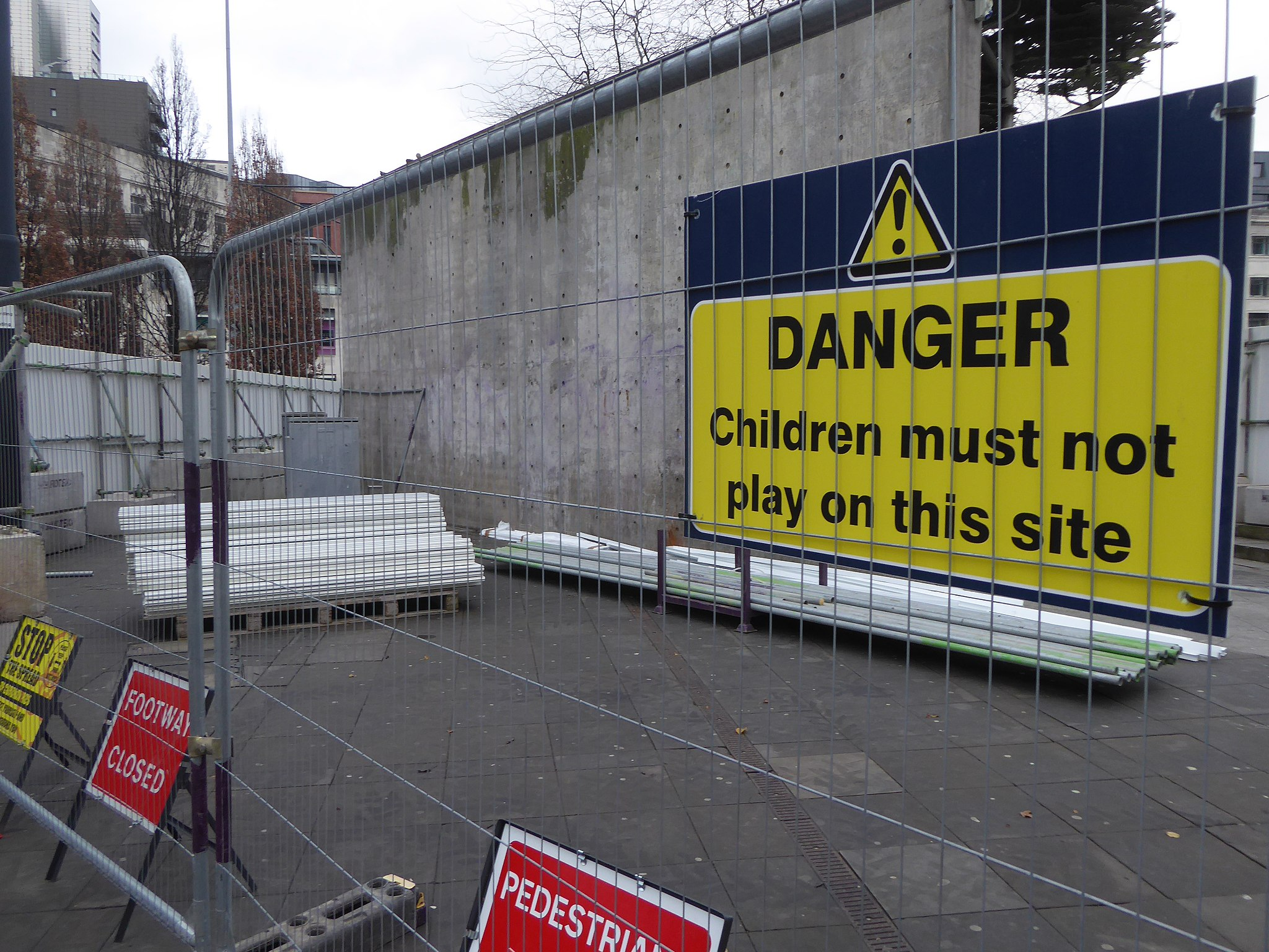 barricades and warning signs at a concrete wall