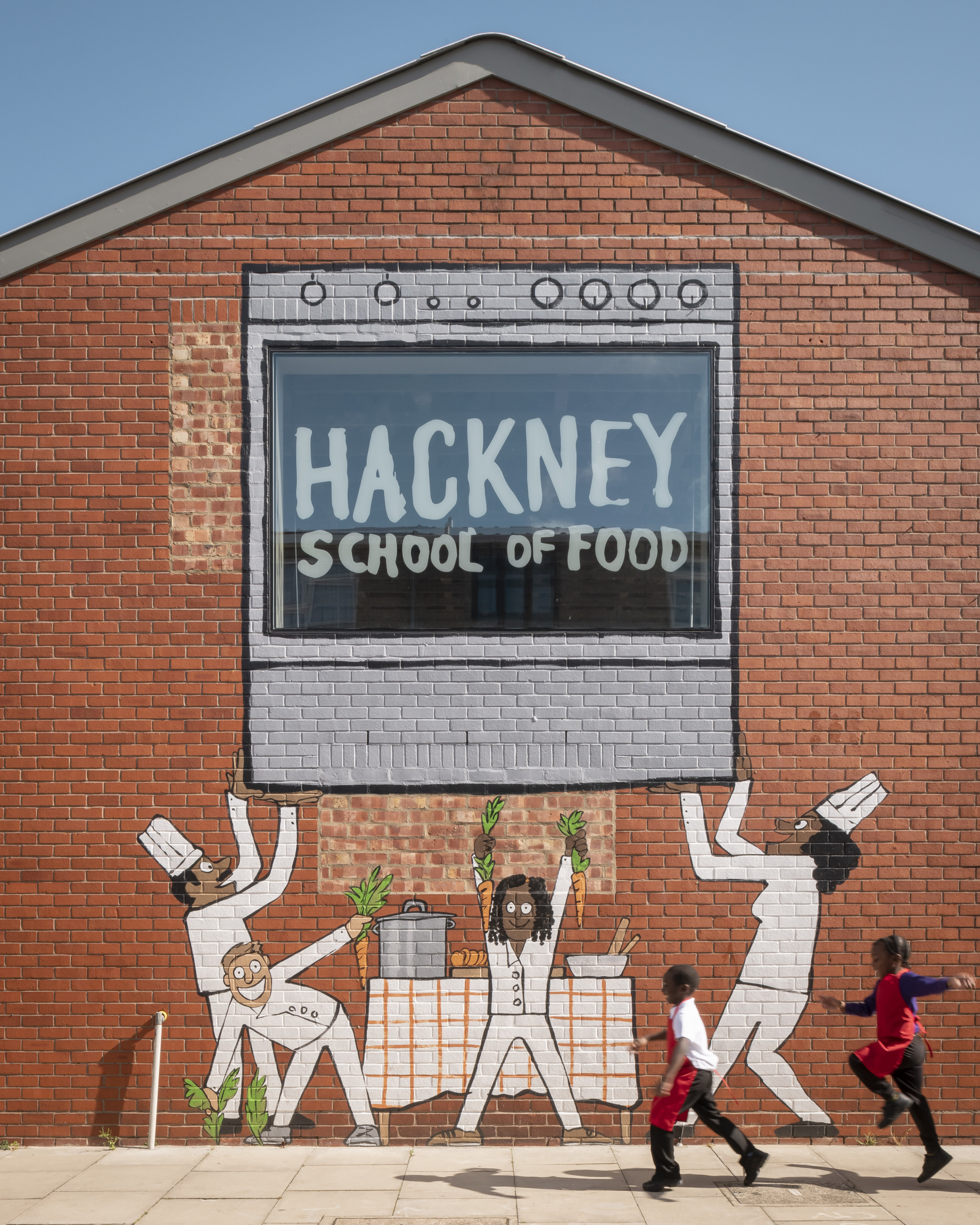 A mural that reads hackney school of food