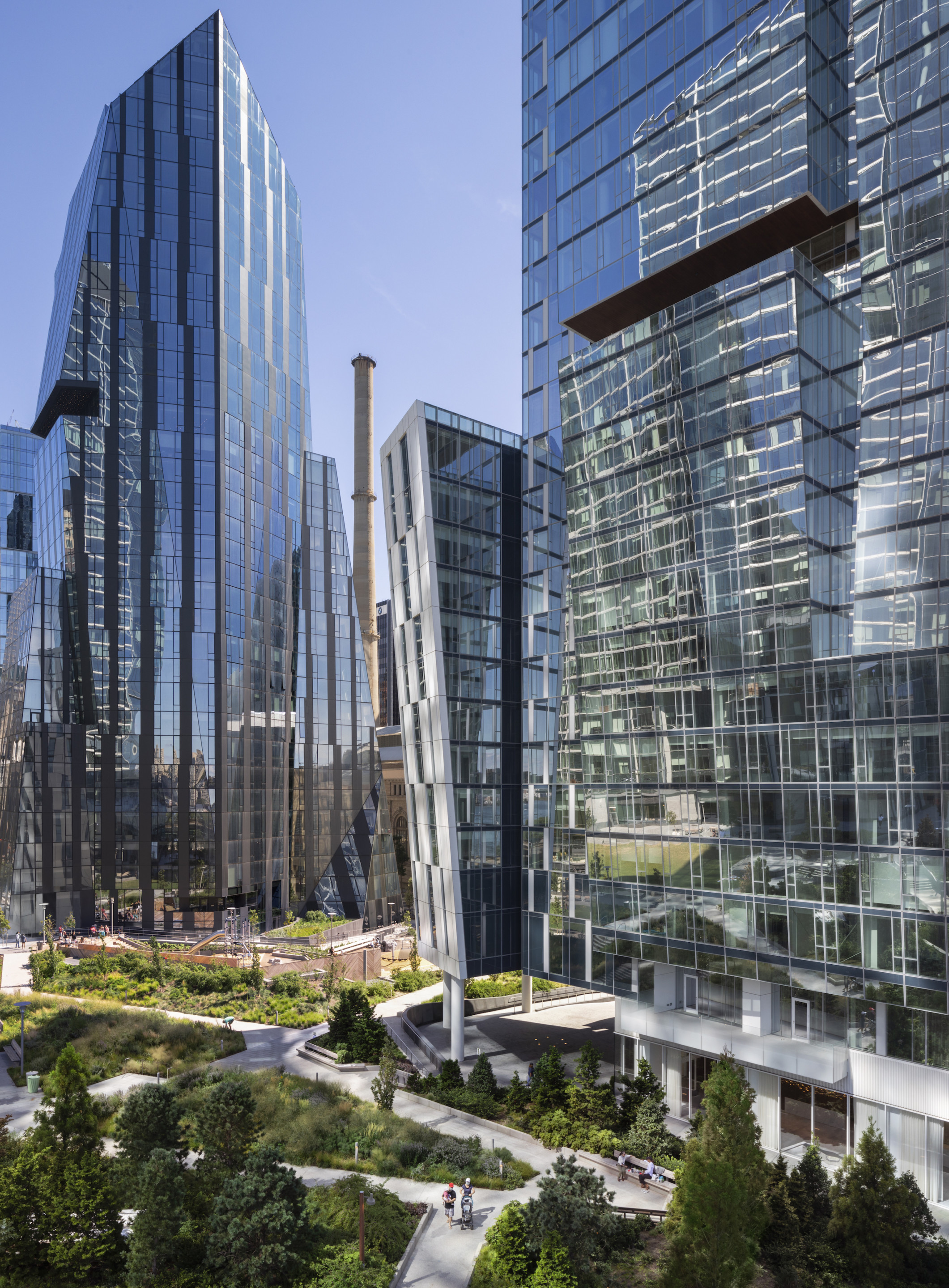 aerial view of a city park surrounded by tall glass towers