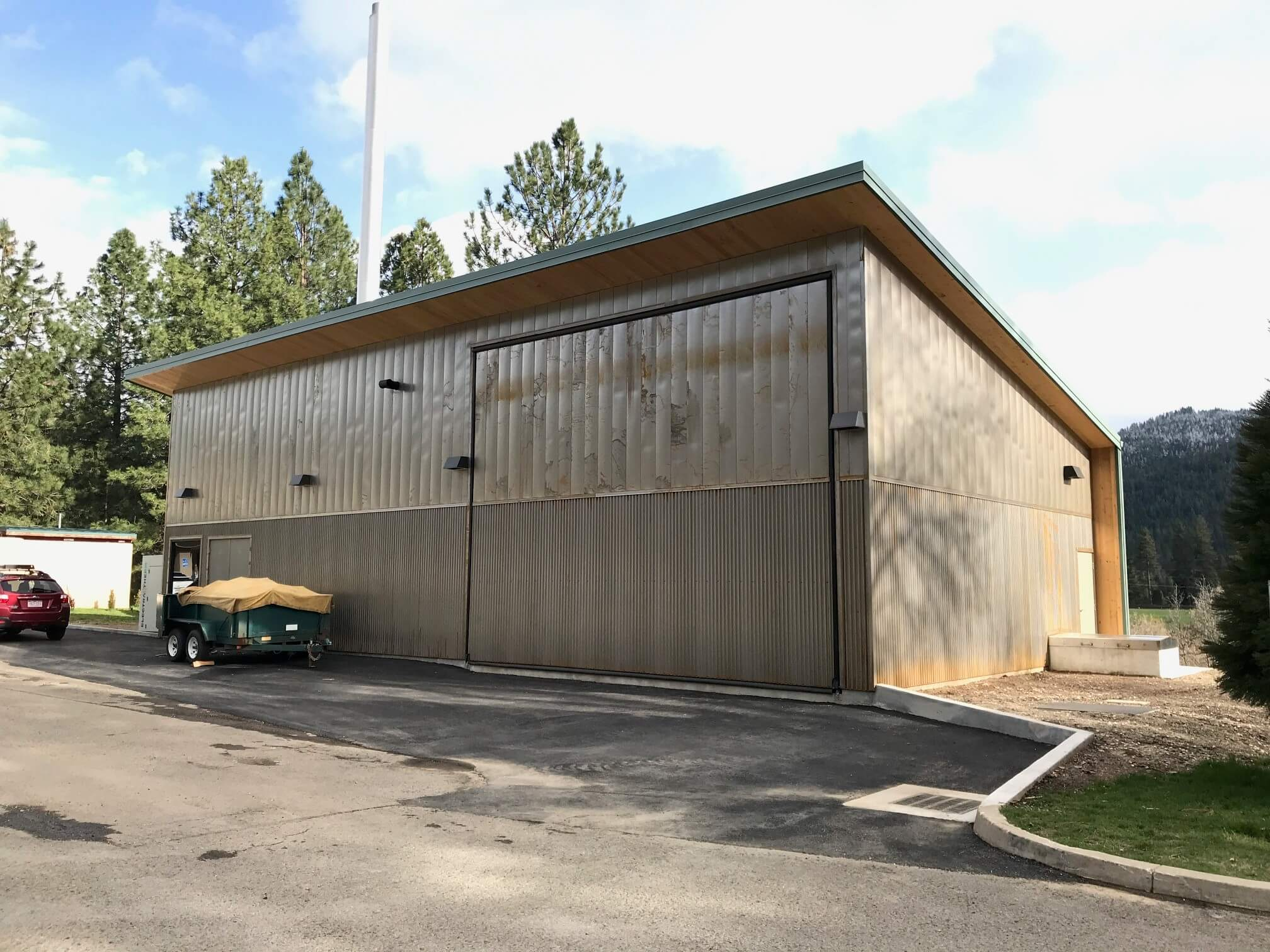 a simple wood building with metal siding