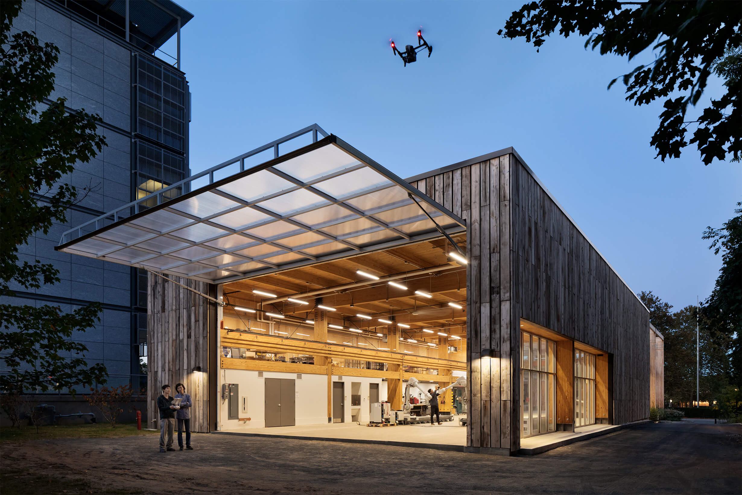 a wooden structure with a large glass garage door opened